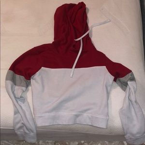 Red, white, grey hoodie.